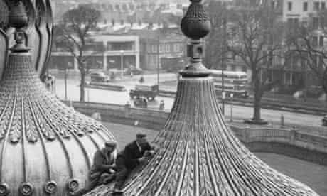 Stonemasons work on the domed roof of the Royal Pavilion in Brighton.