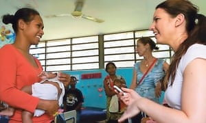 Journalist Charlotte Maugham (right) interviews a women at a clinic in Dili, Timor Leste