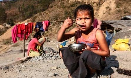 A street child eating in Kathmandu, Nepal