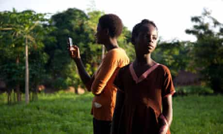 Two women in Nigeria using a mobile phone