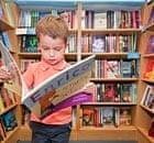 A boy reading a book in a bookshops