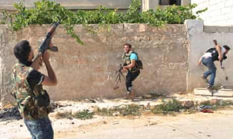 Syrian rebel fires at helicopter