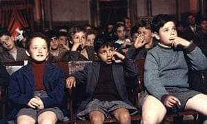 Cinema Paradiso: Salvatore and friends sitting in a cinema