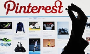 Salesforce:  a woman holding a pin to a computer screen that shows the website Pinterest in Hanover