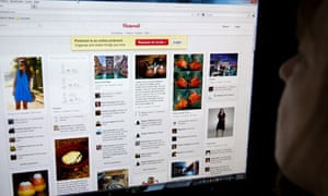 A woman looks at the internet site Pinterest