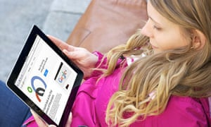 Salesforce: Close up picture of a young woman reading about the new social networking site Google+