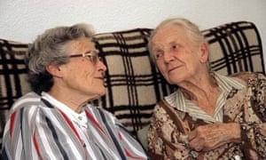 Elderly woman talking to poorly older relative