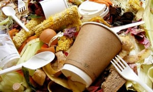 Food waste along with cutlery and paper cups