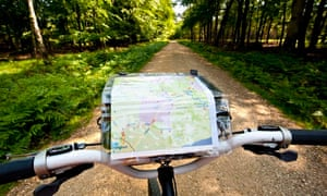 VE cycling: Cyclist With Map Following A Cycle Route Around Brockenhurst, New Forest National Park