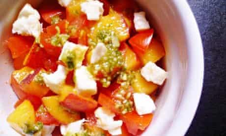 Peach tomato salad with mozzarella and pesto dressing