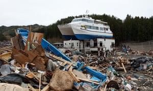 Hamayu catamaran on house after Japan tsunami