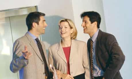 Business associates talking by elevator