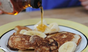 Back to basics: drizzling the pancakes with maple syrup.