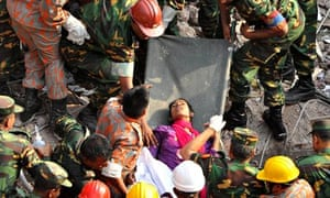 Rescue workers rescue a woman after Rana Plaza building collapse