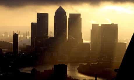 The sun rises over Canary Wharf, City of London
