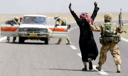 British soldiers stop the vehicle of Iraqi men
