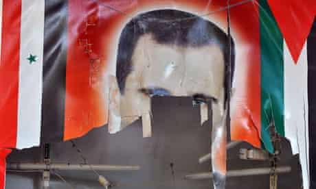 Tattered poster of Bashar al-Assad
