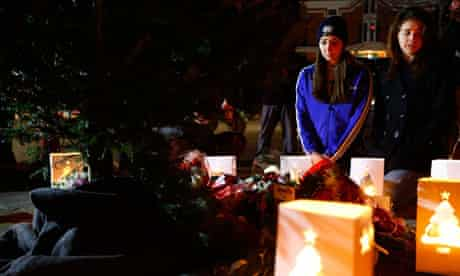 Kelley Sullivan and Erin Nemeth mourn the victims of the Newtown shooting