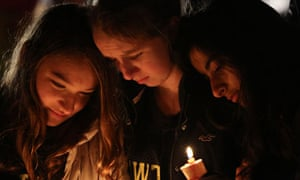 Three people pay their respects at Sandy Hook shooting memorial