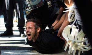Occupy Wall Street protestor Chris Philips screams as he is arrested near Zuccotti Park