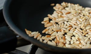 Pine nuts being toasted