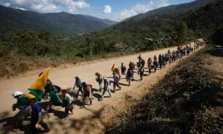 Marchers advance towards La Paz, Bolivia in a protest against a planned highway