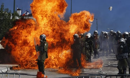 Demonstrators clash with riot police in front of the Greek parliament in Athens