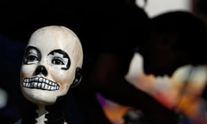 A doll's head, painted as a skull, as part of Day of the Dead celebrations in Mexico City