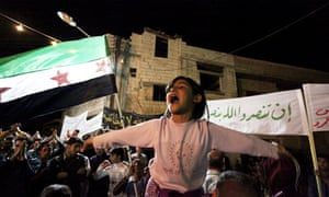 A child at a demonstration in Homs, Syria