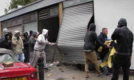 Riots: Youths loot a Carhartt store in Hackney, London
