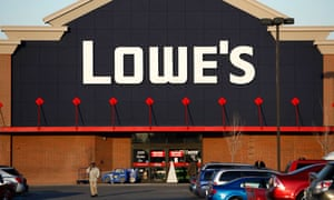 A customer walks out in front of a Lowe's store in Allen Park