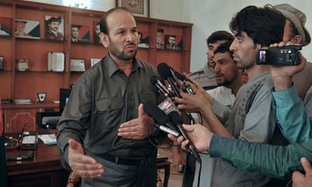 Parwan governor Abdul Basir Salangi talks after a suicide attack on his compound in Charikar