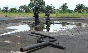 The oil wellhead near the village of K-dere, Ogoniland, Niger, Delta.