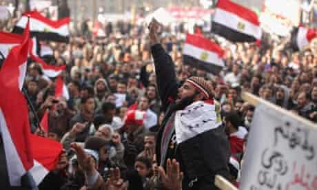 Egyptians gather in Tahrir Square to mark the one year anniversary of the revolution