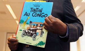 A copy of Tintin in the Congo comic book is held before a hearing in Belgium