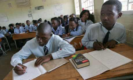 Students at Ibhongo High School, in South Africa's biggest township Soweto, in class