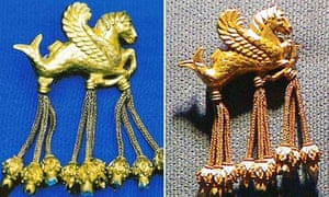 The original, left, and the fake golden brooch in the shape of a winged seahorse
