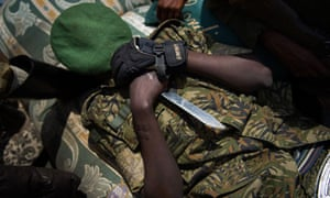 A Congolese M23 rebels sleeps in the back of a truck