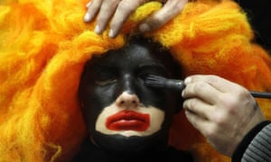 A woman's face is painted to become a Black Pete in Soest, The Netherlands