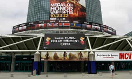 A man walks past signs in place for E3 2012 at the Los Angeles Convention Center