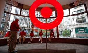 Employees at a new CityTarget store receive instructions in downtown Chicago