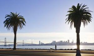 A woman walks her dog on Treasure Island, San Francisco