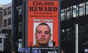 Shooting: Dale Cregan's wanted poster displayed on large digital screens around Manchester