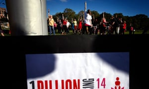 A group of women and men dance at a One Billion Rising event in a park in Sydney