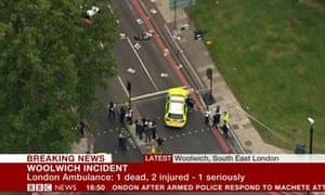 Police at the scene in Woolwich, south London, where a man was killed