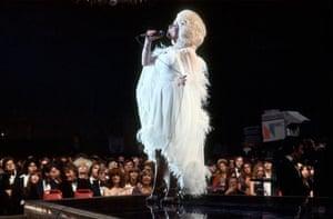 Dolly Parton performs onstage in 1977