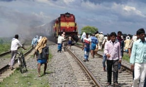 An angry crowd set two coaches of a train on fire after the train ploughed into a crowd of Hindu pil