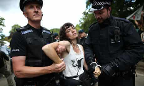 Police officers arrest anti-fracking protesters in Balcombe, West Sussex