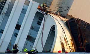 Engineers work on the bow of the Costa Concordia