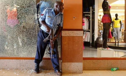 A police officer tries to secure an area inside the Westgate Shopping Centre where gunmen went on a